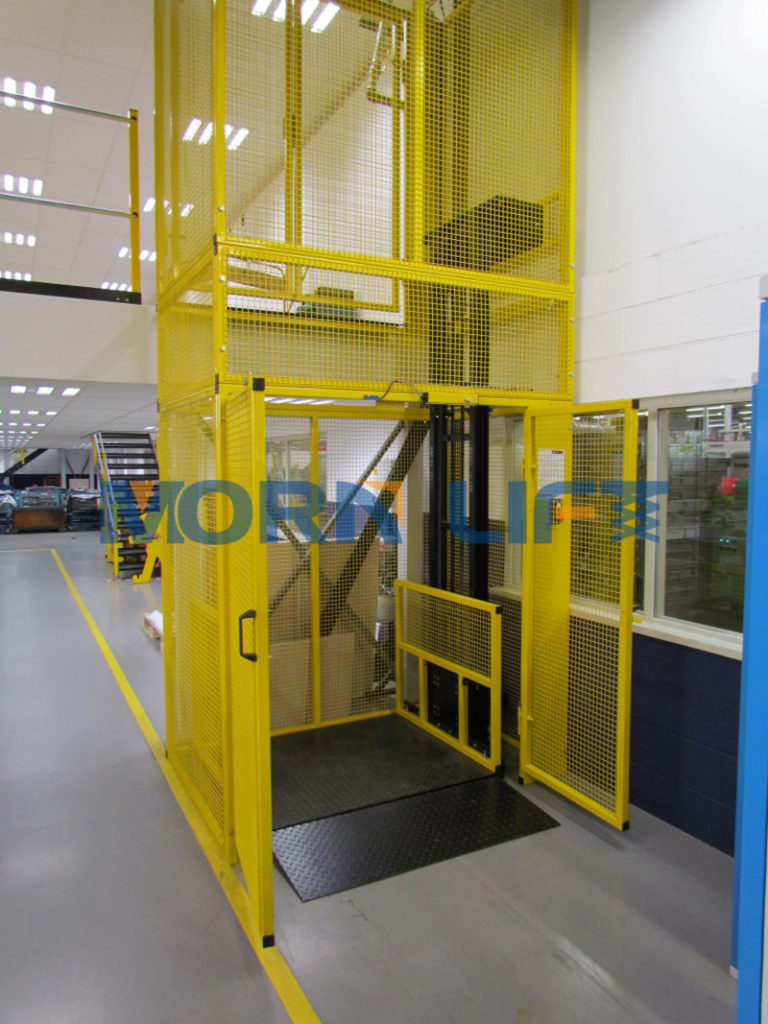 freight elevator with steel mesh enclosure