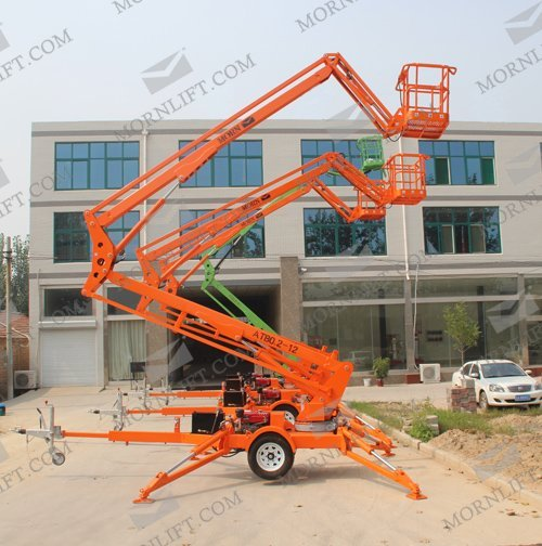 Trailing articulated boom lift